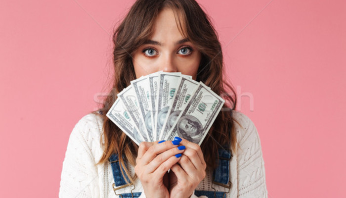 9290724 stock photo portrait of a pretty young girl holding money