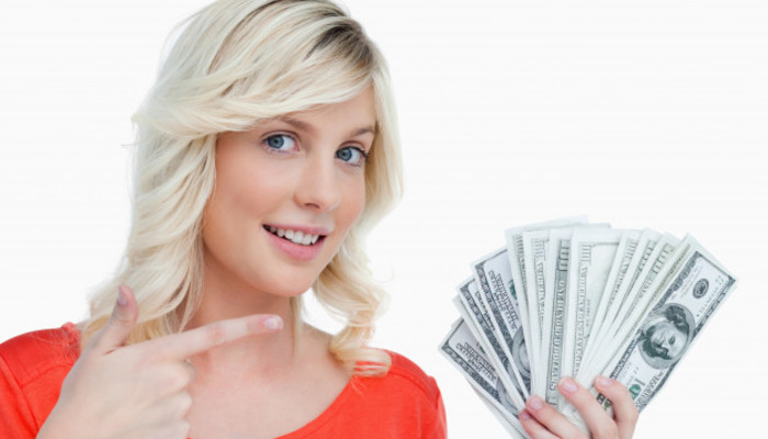 Smiling woman pointing her dollar notes with her finger 13339 288086