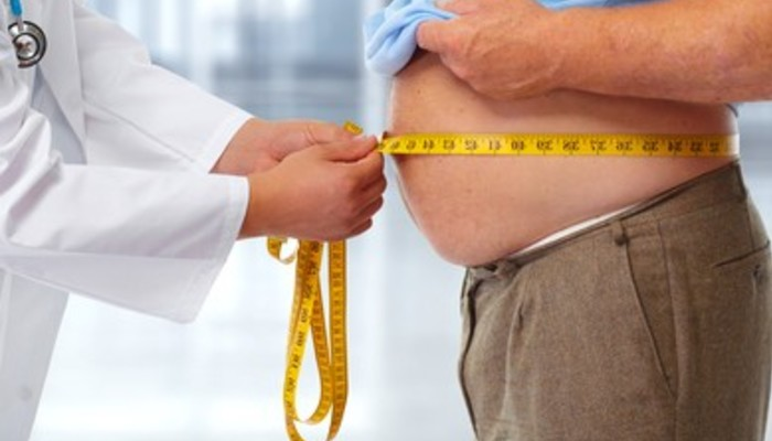 Doctor measuring obese man waist 260nw 348926726